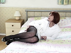 Naughty British mature lady playing with her wet fuckbox