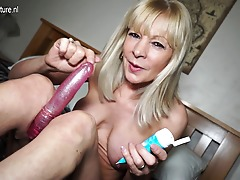 Naughty Brit mature lady frolicking with her dildo