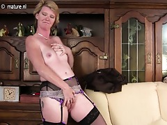 Naughty British housewife frolicking with her wet pussy
