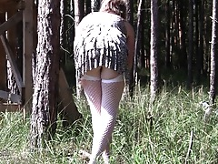 Spraying mature slut masturbating in the woods